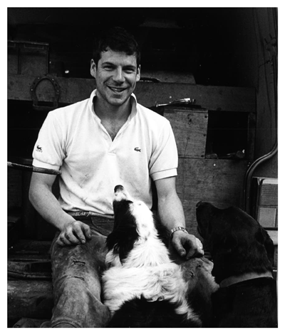 The man himself, Ben Chamberlain, Black and white image with his collie dogs.