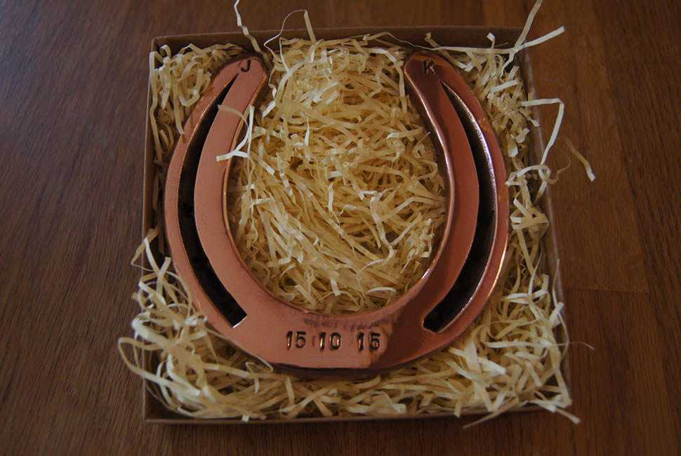 Final item of a copper horse shoe that has been polished and put into a rustic box with thin paper to look like hay. Date of 15-10-15 stamped into horse shoe.